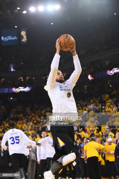 Stephen Curry of the Golden State Warriors warms up before the game against the Cleveland Cavaliers in Game Five of the 2017 NBA Finals on June 12...
