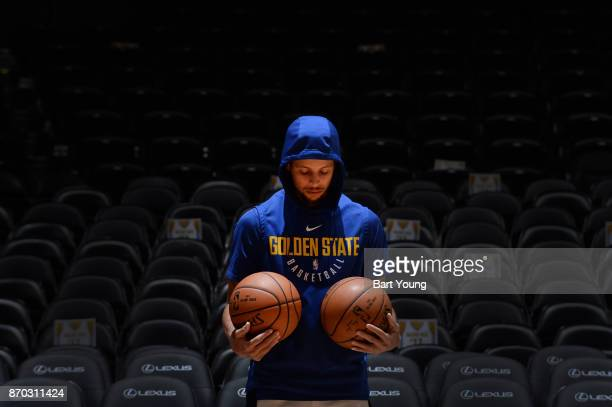 Stephen Curry of the Golden State Warriors warms up before the game against the Denver Nuggets on November 4 2017 at the Pepsi Center in Denver...