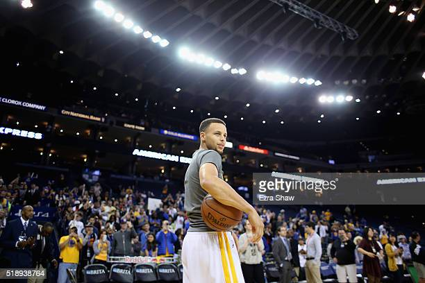 Stephen Curry of the Golden State Warriors warms up before their game against the Portland Trail Blazers at ORACLE Arena on April 3 2016 in Oakland...
