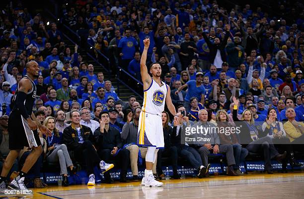 Stephen Curry of the Golden State Warriors watches a threepoint basket go in against the San Antonio Spurs at ORACLE Arena on January 25 2016 in...