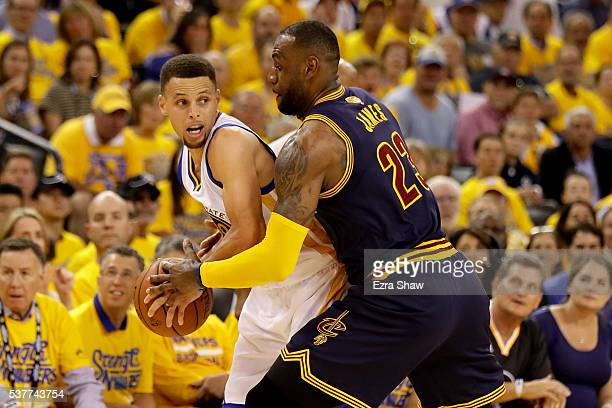 Stephen Curry of the Golden State Warriors with the ball against LeBron James of the Cleveland Cavaliers in Game 1 of the 2016 NBA Finals at ORACLE...