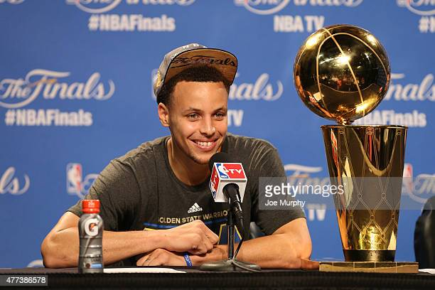 Stephen Curry of the Golden State Warriors with the Larry O'Brien Championship Trophy at the post game press conference after Game Six of the 2015...