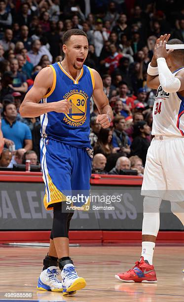 Stephen Curry of the of the Golden State Warriors celebrates against the Los Angeles Clippers on November 19 2015 at STAPLES Center in Los Angeles...