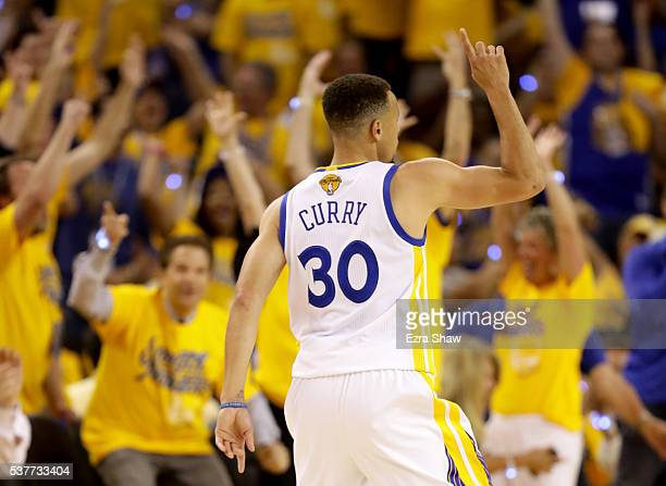 Stephen Curry of the rGolden State Warriors reacts after making a three pointer in the first half against the Cleveland Cavaliers in Game 1 of the...