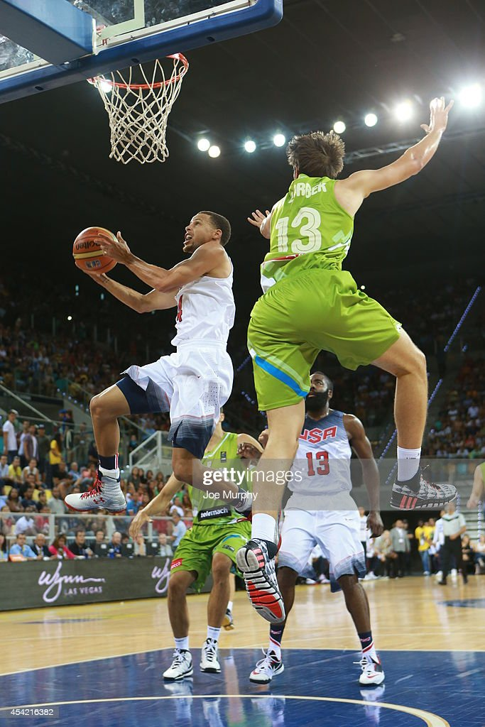 <a gi-track='captionPersonalityLinkClicked' href=/galleries/search?phrase=Stephen+Curry+-+Basketball+Player&family=editorial&specificpeople=5040623 ng-click='$event.stopPropagation()'>Stephen Curry</a> #4 of the USA Basketball Men's National Team drives to the basket against the Slovenia Basketball Men's National Team on August 26, 2014 at Gran Canaria Arena in Las Palmas, Gran Canaria, Spain.