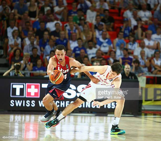 Stephen Curry of the USA Basketball Men's National Team fights for the ball against Cedi Osman the Turkey Basketball Men's National Team during the...
