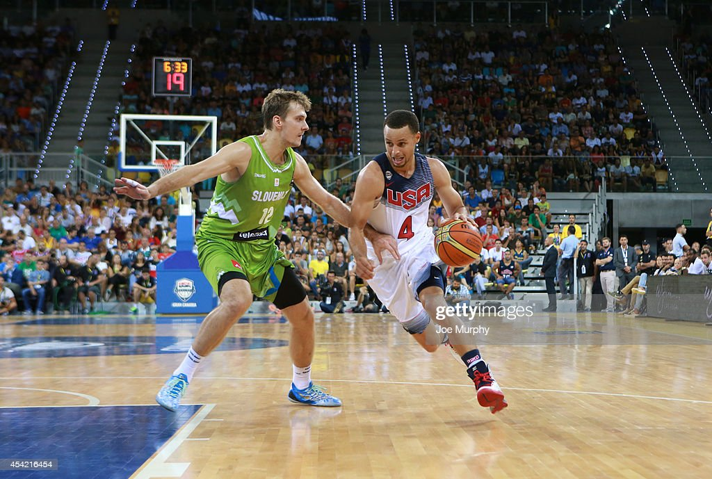 <a gi-track='captionPersonalityLinkClicked' href=/galleries/search?phrase=Stephen+Curry+-+Basketball+Player&family=editorial&specificpeople=5040623 ng-click='$event.stopPropagation()'>Stephen Curry</a> #4 of the USA Basketball Men's National Team handles the ball against the Slovenia Basketball Men's National Team on August 26, 2014 at Gran Canaria Arena in Las Palmas, Gran Canaria, Spain.
