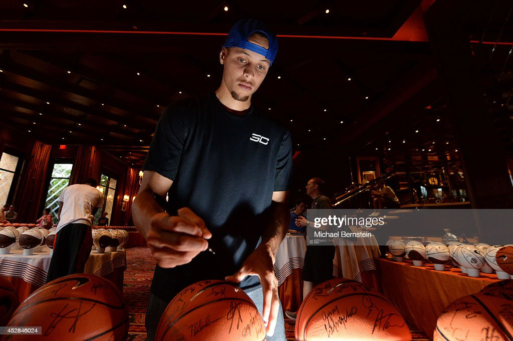 Stephen Curry #43 of the USA Basketball Men's National Team signs basketballs at the Wynn Las Vegas on July 27, 2014 in Las Vegas, Nevada.