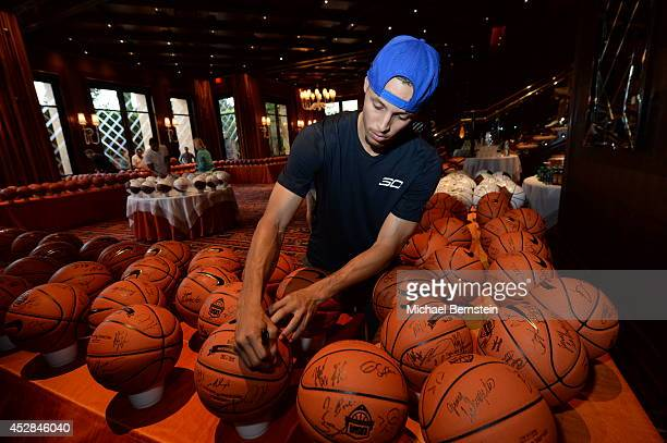 Stephen Curry of the USA Basketball Men's National Team signs basketballs at the Wynn Las Vegas on July 27 2014 in Las Vegas Nevada NOTE TO USER User...