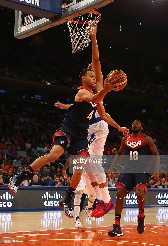 <a gi-track='captionPersonalityLinkClicked' href=/galleries/search?phrase=Stephen+Curry+-+Basketball+Player&family=editorial&specificpeople=5040623 ng-click='$event.stopPropagation()'>Stephen Curry</a> #4 of the USA passes against Puerto Rico during their game at Madison Square Garden on August 22, 2014 in New York City.
