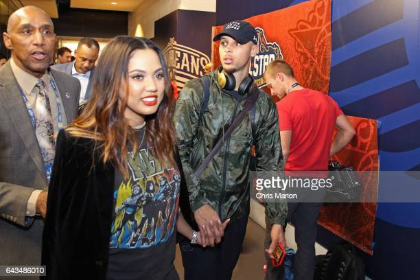 Stephen Curry of the Western Conference AllStar Team exits the locker room with his wife Ayesha Curry during the NBA AllStar Game as part of the 2017...