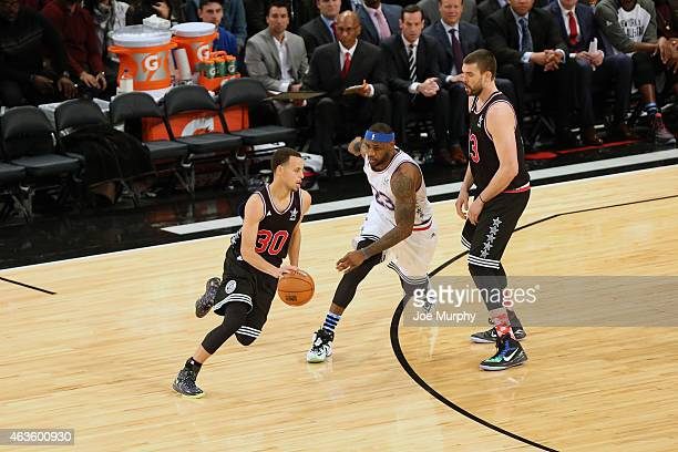Stephen Curry of the Western Conference handles the ball against LeBron James of the Eastern Conference during the 64th NBA AllStar Game presented by...