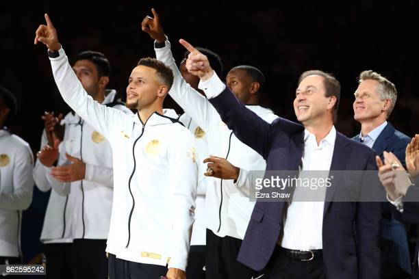 Stephen Curry owner Joe Lacob and the Golden State Warriors point to their 2017 NBA Championship banner prior to their NBA game against the Houston...