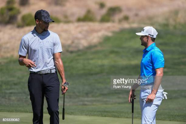 Stephen Curry talks with his playing partner Taylor Moore during practice for the Webcom Tour Ellie Mae Classic at TPC Stonebrae on August 1 2017 in...