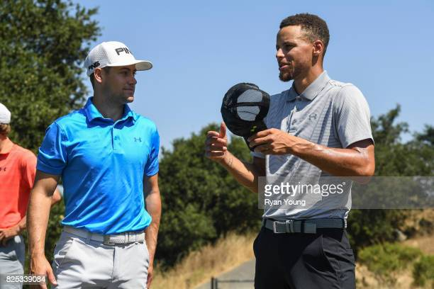 Stephen Curry talks with Taylor Moore during practice for the Webcom Tour Ellie Mae Classic at TPC Stonebrae on August 1 2017 in Hayward California