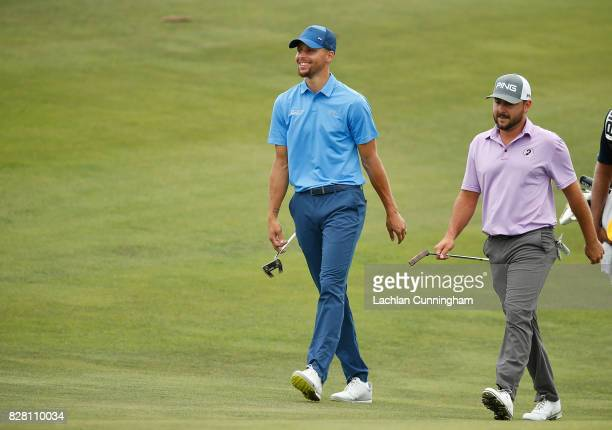 Stephen Curry walks the seventeenth fairway with playing partner Stephan Jaeger of Germany during round one of the Ellie Mae Classic at TCP Stonebrae...