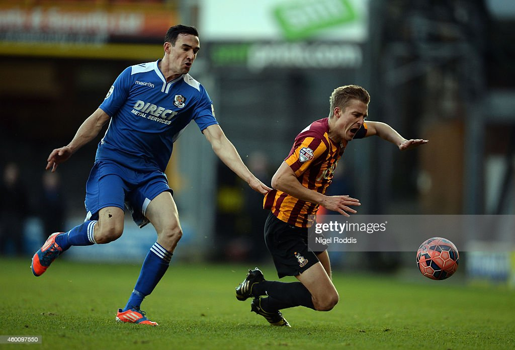 Stephen Darby of Bradford City (R) is challenged by Tom Bradbrook of Dartford during the FA Cup Second Round football match between Bradford City and Dartford at Coral Windows Stadium, Valley Parade on December 7, 2014 in Bradford, England.