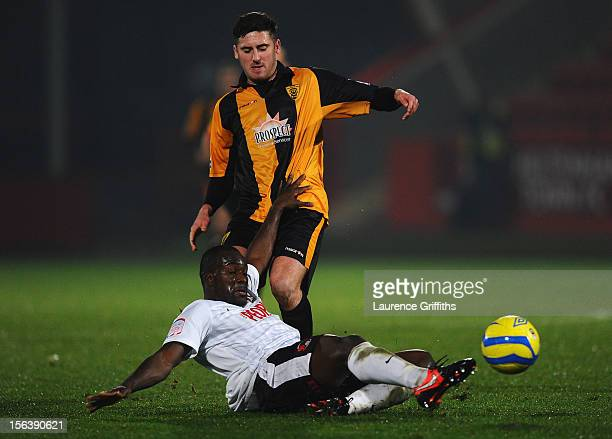 Stephen Davies of Gloucester City battles with Anthony Griffith of Leyton Orient during the FA Cup First Round match between Gloucester City and...