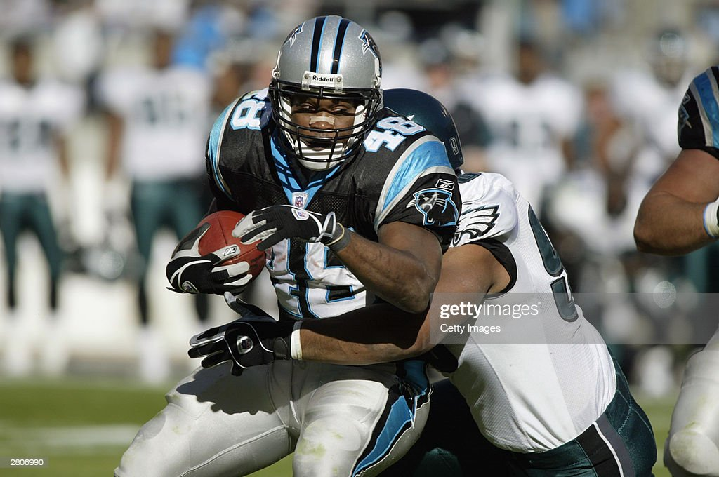 Stephen Davis #48 of the Carolina Panthers is tackeld during the game of the Philadelphia Eagles during the game on November 30, 2003 at Ericsson Stadium in Charlotte, North Carolina. The Eagles defeated the Panthers 25-15.