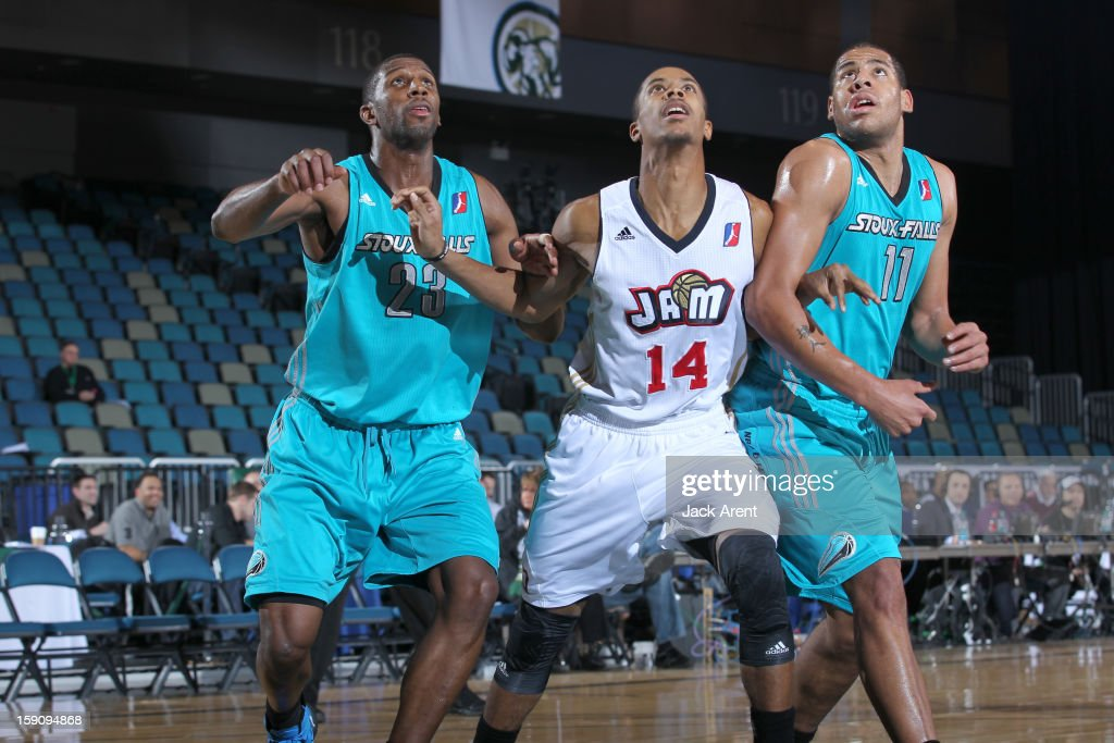 Stephen Dennis #14 of the Bakersfield Jam looks to rebound the ball over Demetris Nichols #23 and Mark Tyndale #11of the Sioux Falls Skyforce during the 2013 NBA D-League Showcase on January 7, 2013 at the Reno Events Center in Reno, Nevada.