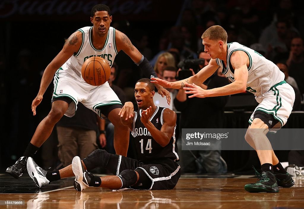 Stephen Dennis #14 of the Brooklyn Nets in action against Fab Melo #13 and Micah Downs #55 of the Boston Celtics during a preseason game at the Barclays Center on October 18, 2012 in the Brooklyn borough of New York City. The Celtics defeated the Nets 115-85.