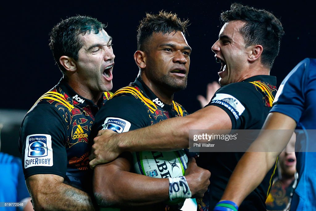 Stephen Donald (L) and James Lowe (R) celebrate the try from Seta Tamanivalu (C) during the round seven Super Rugby match between the Chiefs and the Blues on April 8, 2016 in Hamilton, New Zealand.