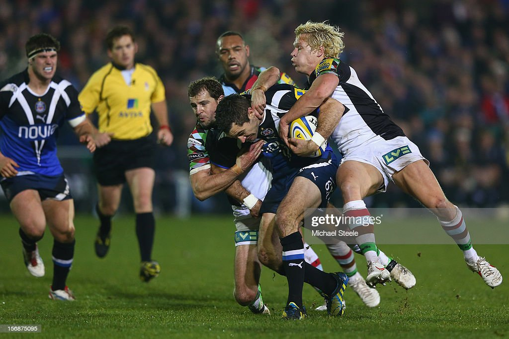 Stephen Donald (C) of Bath is held up by Matt Hopper (R) and <a gi-track='captionPersonalityLinkClicked' href=/galleries/search?phrase=Nick+Evans+-+Rugby+Player&family=editorial&specificpeople=724634 ng-click='$event.stopPropagation()'>Nick Evans</a> (L) of Harlequins during the Aviva Premiership match between Bath and Harlequins at the Recreation Ground on November 23, 2012 in Bath, England.