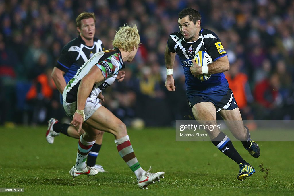 Stephen Donald (R) of Bath runs at Matt Hopper (L) of Harlequins during the Aviva Premiership match between Bath and Harlequins at the Recreation Ground on November 23, 2012 in Bath, England.