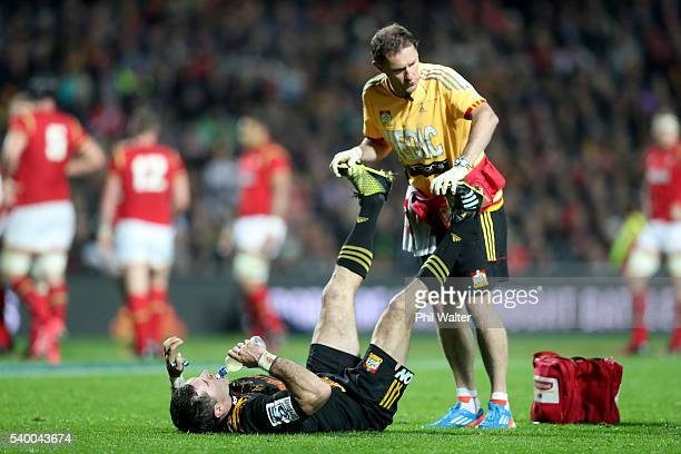 Stephen Donald of the Chiefs cramps up during the International Test match between the Chiefs and Wales at Waikato Stadium on June 14 2016 in...