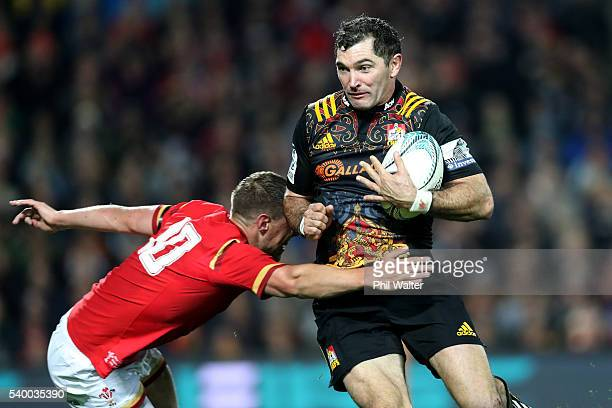 Stephen Donald of the Chiefs is tackled by Rhys Priestland of Wales during the International Test match between the Chiefs and Wales at Waikato...