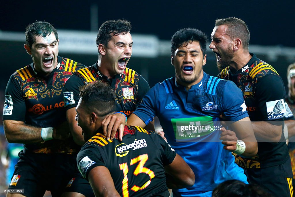 Stephen Donald,James Lowe and Aaron Cruden celebrate the try from Seta Tamanivalu (13) during the round seven Super Rugby match between the Chiefs and the Blues on April 8, 2016 in Hamilton, New Zealand.