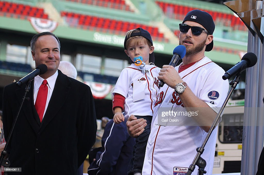Stephen Drew addresses the crowd at Fenway Park as Don Orsillo looks on before boarding the duck boats for the Boston Red Sox victory parade on November 2, 2013 in Boston, Massachusetts.