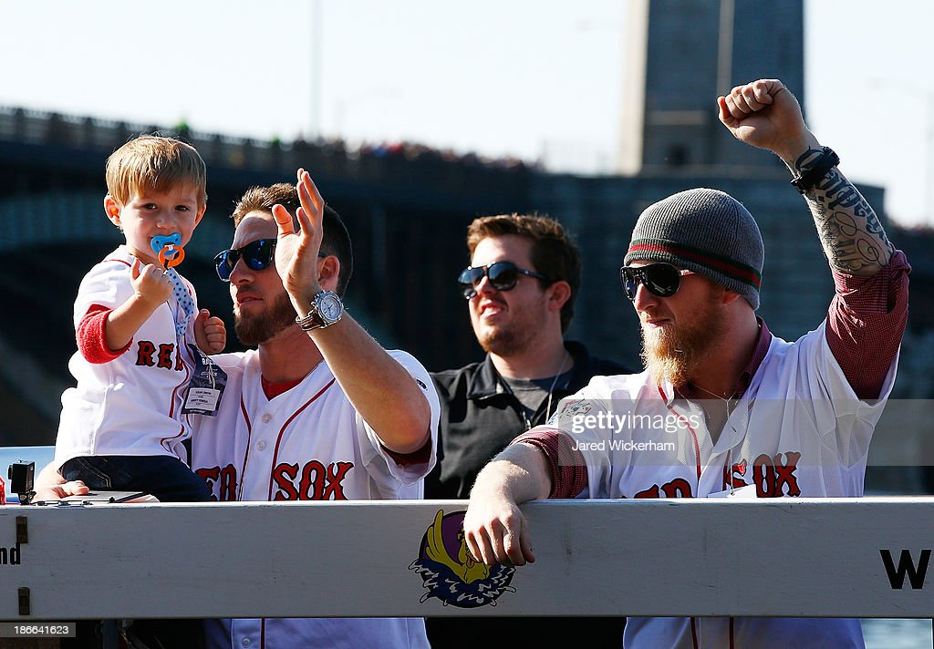 <a gi-track='captionPersonalityLinkClicked' href=/galleries/search?phrase=Stephen+Drew&family=editorial&specificpeople=757520 ng-click='$event.stopPropagation()'>Stephen Drew</a> #7 and Mike Carp #37 of the Boston Red Sox celebrate on the Charles River during the World Series victory parade on November 2, 2013 in Boston, Massachusetts.