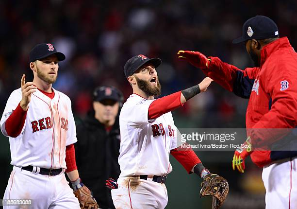 Stephen Drew Dustin Pedroia and David Ortiz of the Boston Red Sox celebrate a 81 win against the St Louis Cardinals in Game One of the World Series...