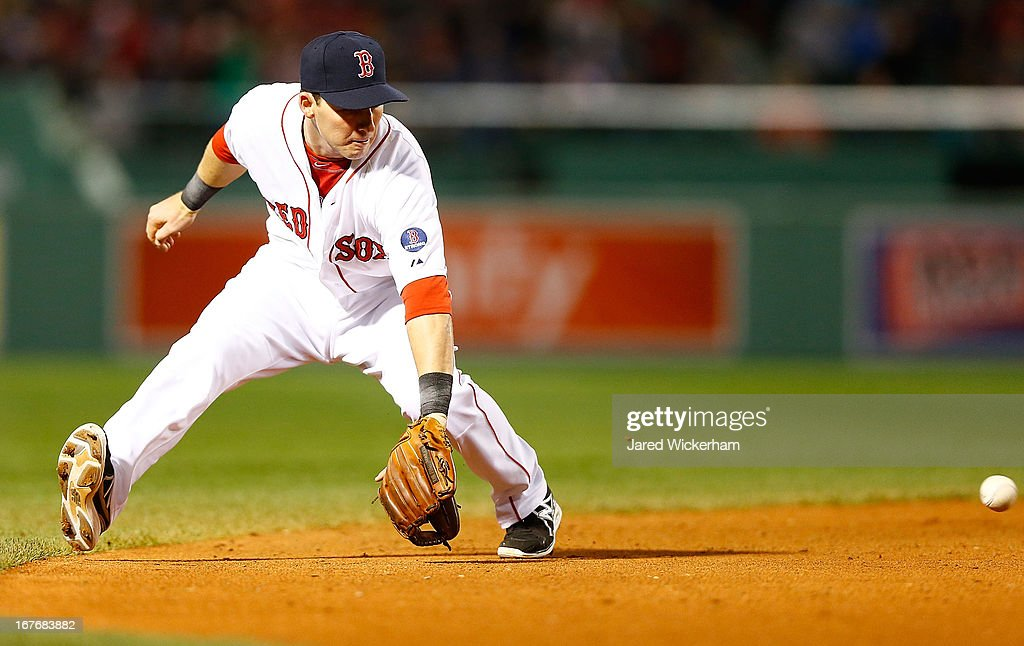 <a gi-track='captionPersonalityLinkClicked' href=/galleries/search?phrase=Stephen+Drew&family=editorial&specificpeople=757520 ng-click='$event.stopPropagation()'>Stephen Drew</a> #7 of the Boston Red Sox attempts to field a ground ball against the Houston Astros during the game on April 27, 2013 at Fenway Park in Boston, Massachusetts.