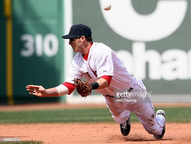 Stephen Drew of the Boston Red Sox cannot make a catch at second base against the Tampa Bay Rays at Fenway Park on April 15 2013 in Boston...