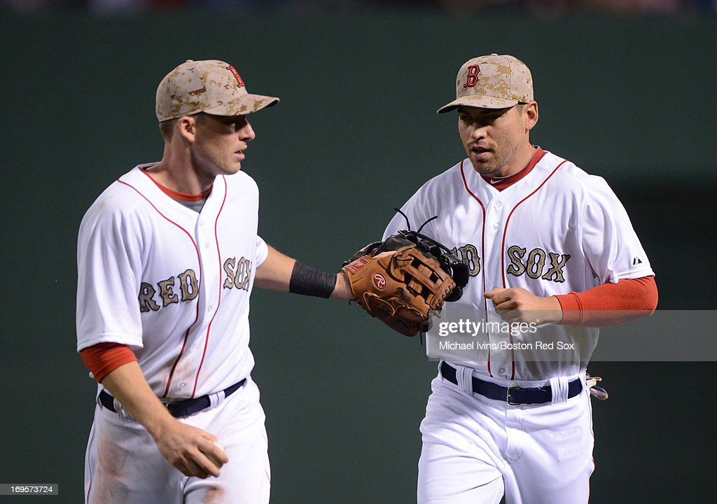 <a gi-track='captionPersonalityLinkClicked' href=/galleries/search?phrase=Stephen+Drew&family=editorial&specificpeople=757520 ng-click='$event.stopPropagation()'>Stephen Drew</a> #7 of the Boston Red Sox congratulates <a gi-track='captionPersonalityLinkClicked' href=/galleries/search?phrase=Jacoby+Ellsbury&family=editorial&specificpeople=4172583 ng-click='$event.stopPropagation()'>Jacoby Ellsbury</a> #5 after Ellsbury made a catch in deep center field against the Philadelphia Phillies in the fifth inning on May 27, 2013 at Fenway Park in Boston, Massachusetts.