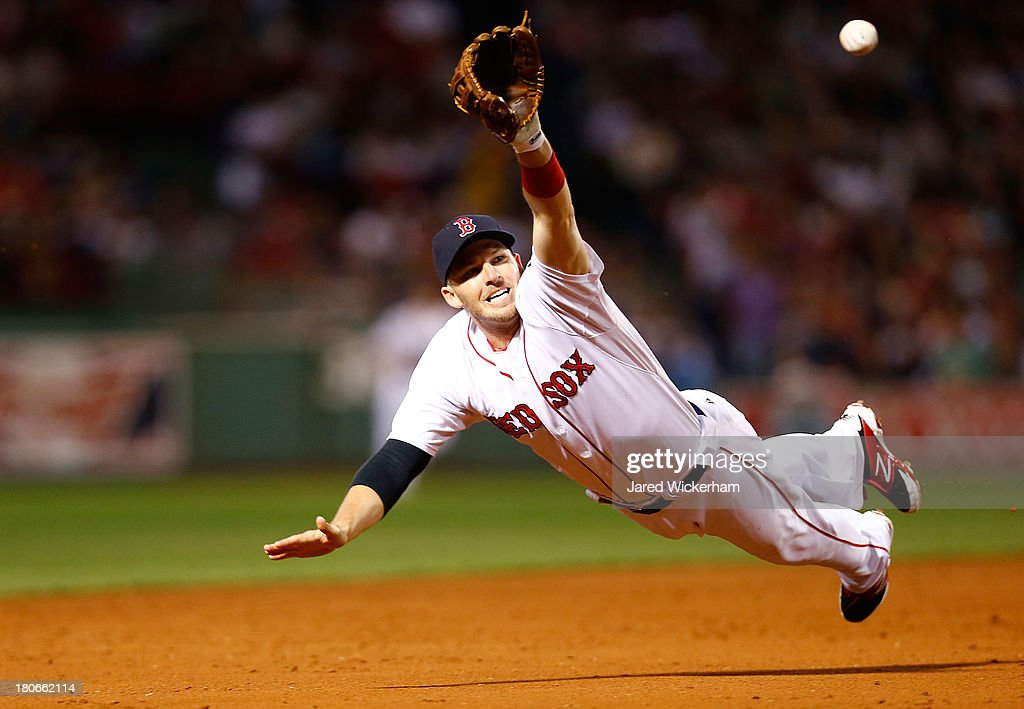 Stephen Drew #7 of the Boston Red Sox dives but comes up short for a ball hit down the third base line against the New York Yankees during the game on September 15, 2013 at Fenway Park in Boston, Massachusetts.