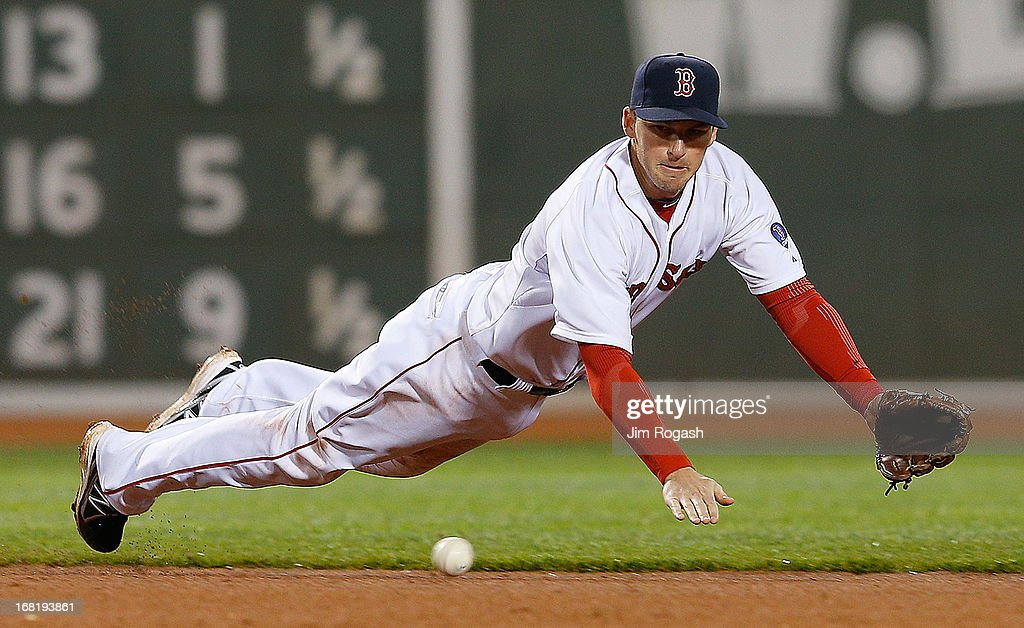 Stephen Drew #7 of the Boston Red Sox dives for a ball hit by Brian Dozier #2 of the Minnesota Twins in the 6th inning but is unable to throw Dozier out at Fenway Park on May 6, 2013 in Boston, Massachusetts.