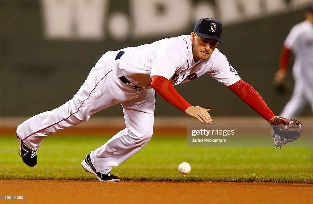 <a gi-track='captionPersonalityLinkClicked' href=/galleries/search?phrase=Stephen+Drew&family=editorial&specificpeople=757520 ng-click='$event.stopPropagation()'>Stephen Drew</a> #7 of the Boston Red Sox dives for a ground ball against the Minnesota Twins during the game on May 9, 2013 at Fenway Park in Boston, Massachusetts.