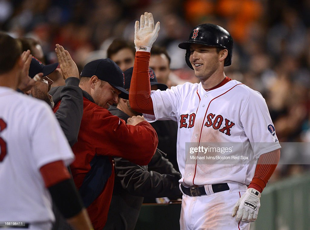 Stephen Drew #7 of the Boston Red Sox is congratulated after hitting a home run against the Minnesota Twins in the seventh inning on May 6, 2013 at Fenway Park in Boston, Massachusetts.