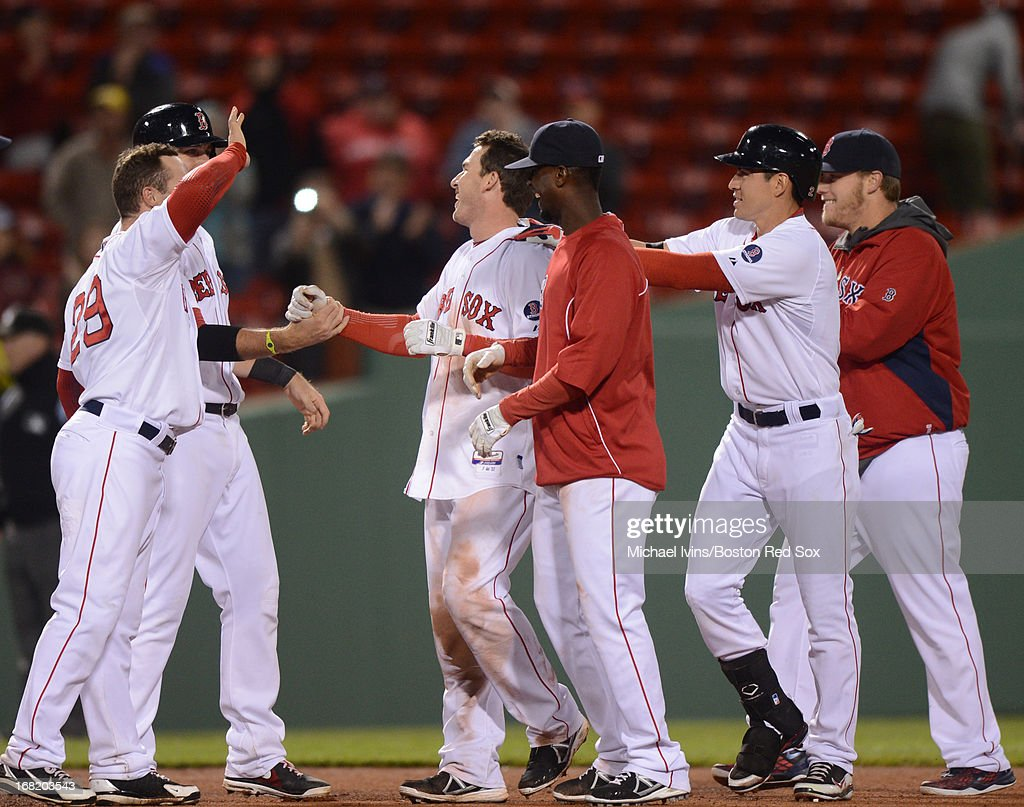 Stephen Drew #7 of the Boston Red Sox is congratulated by teammates after hitting a game-winning RBI double against the Minnesota Twins in the eleventh inning on May 6, 2013 at Fenway Park in Boston, Massachusetts.