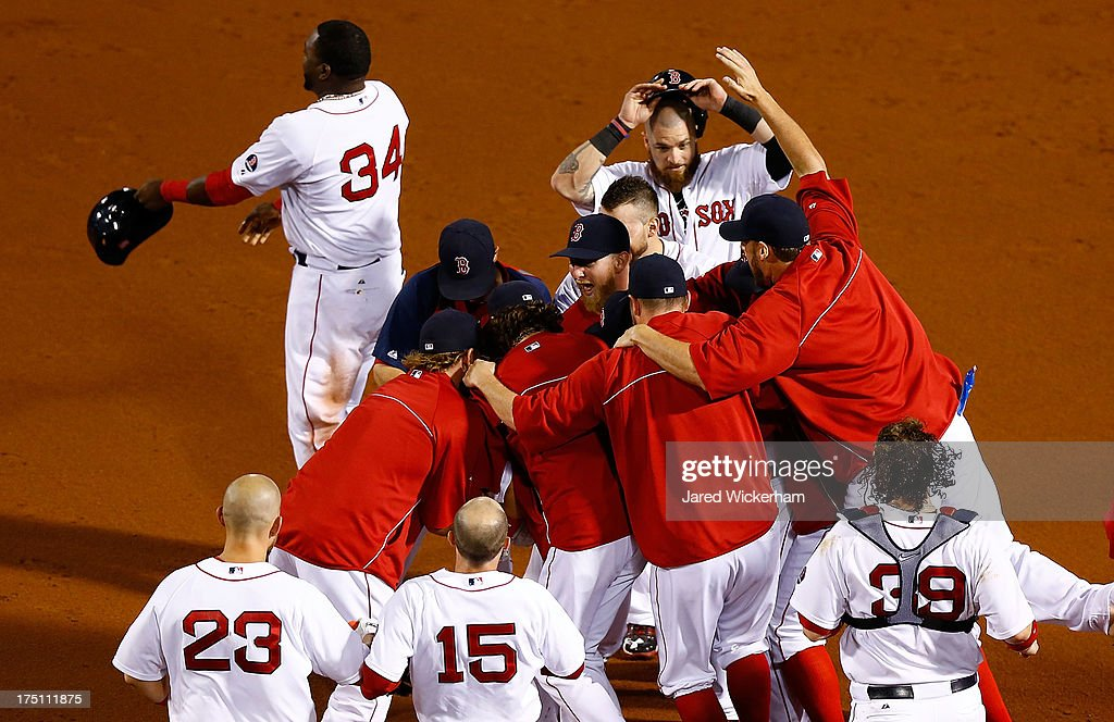 <a gi-track='captionPersonalityLinkClicked' href=/galleries/search?phrase=Stephen+Drew&family=editorial&specificpeople=757520 ng-click='$event.stopPropagation()'>Stephen Drew</a> #7 of the Boston Red Sox is mobbed by his teammates following the game-winning hit in the bottom of the 15th inning against the Seattle Mariners to score Dustin Pedroia #15 of the Boston Red Sox during the game on August 1, 2013 at Fenway Park in Boston, Massachusetts.