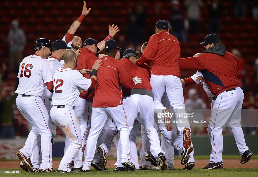 Stephen Drew #7 of the Boston Red Sox is mobbed by teammates after hitting a game-winning RBI double against the Minnesota Twins in the eleventh inning on May 6, 2013 at Fenway Park in Boston, Massachusetts.