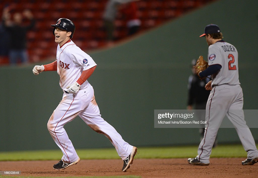 Stephen Drew #7 of the Boston Red Sox reacts in front of Brain Dozier #2 of the Minnesota Twins after hitting a game-winning RBI double in the eleventh inning on May 6, 2013 at Fenway Park in Boston, Massachusetts.