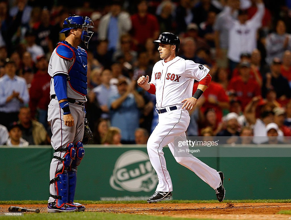 <a gi-track='captionPersonalityLinkClicked' href=/galleries/search?phrase=Stephen+Drew&family=editorial&specificpeople=757520 ng-click='$event.stopPropagation()'>Stephen Drew</a> #7 of the Boston Red Sox scores by <a gi-track='captionPersonalityLinkClicked' href=/galleries/search?phrase=A.J.+Pierzynski&family=editorial&specificpeople=204486 ng-click='$event.stopPropagation()'>A.J. Pierzynski</a> #12 of the Texas Rangers in the 7th inning at Fenway Park on June 4, 2013 in Boston, Massachusetts.