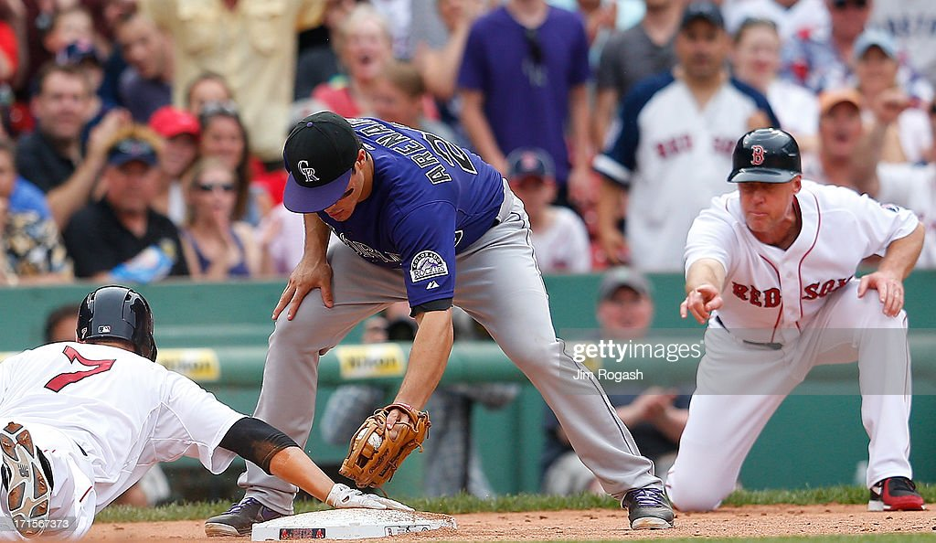 Stephen Drew #7 of the Boston Red Sox slides in to third on a triple as Nolan Arenado #28 of the Colorado Rockies is late with the tag in the 6th inning at Fenway Park on June 26, 2013 in Boston, Massachusetts.