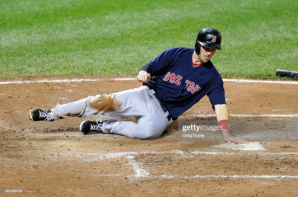 <a gi-track='captionPersonalityLinkClicked' href=/galleries/search?phrase=Stephen+Drew&family=editorial&specificpeople=757520 ng-click='$event.stopPropagation()'>Stephen Drew</a> #7 of the Boston Red Sox slides into home plate and scores in the fifth inning against the Baltimore Orioles at Oriole Park at Camden Yards on September 28, 2013 in Baltimore, Maryland.