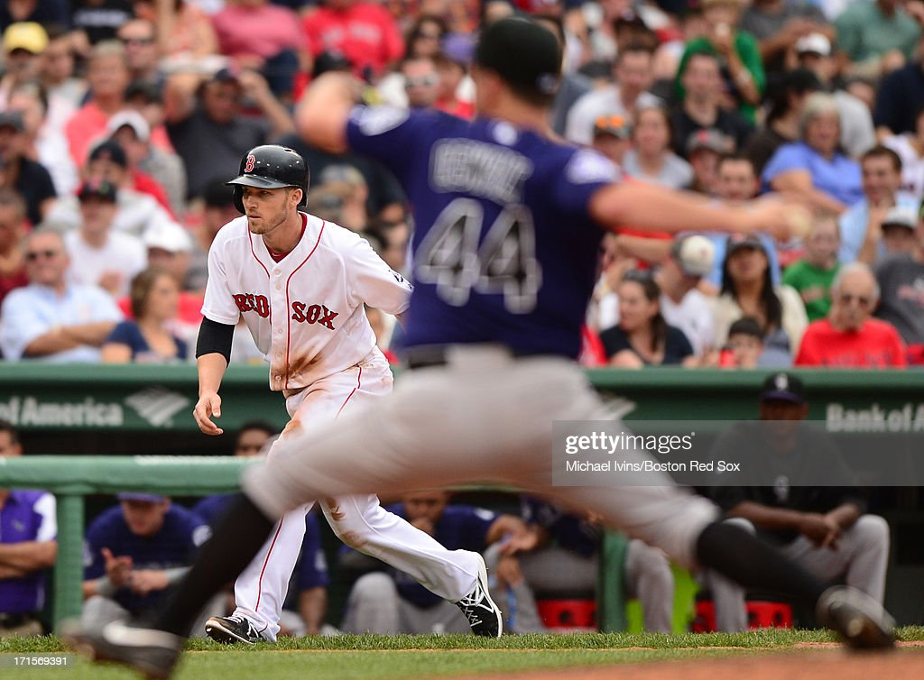 Stephen Drew #7 of the Boston Red Sox takes a lead from third base with Roy Oswald #44 of the Colorado Rockies pitches in the sixth inning on June 26, 2013 at Fenway Park in Boston, Massachusetts.