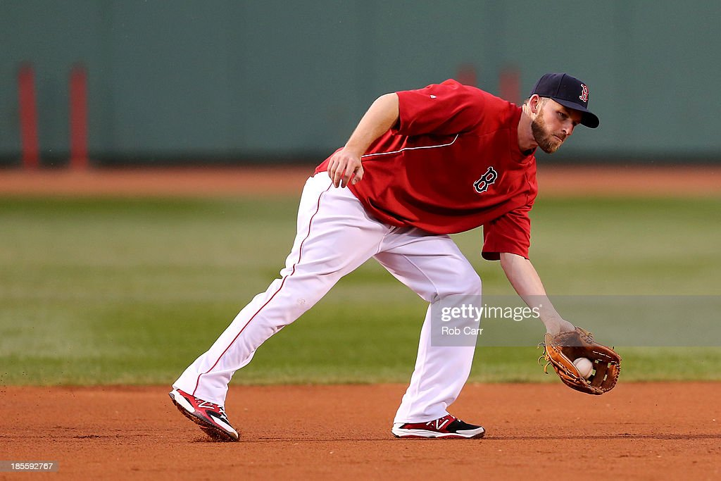 Stephen Drew #7 of the Boston Red Sox warms up during team workout in the 2013 World Series Media Day at Fenway Park on October 22, 2013 in Boston, Massachusetts. The Red Sox host the Cardinals in Game 1 on October 23, 2013.